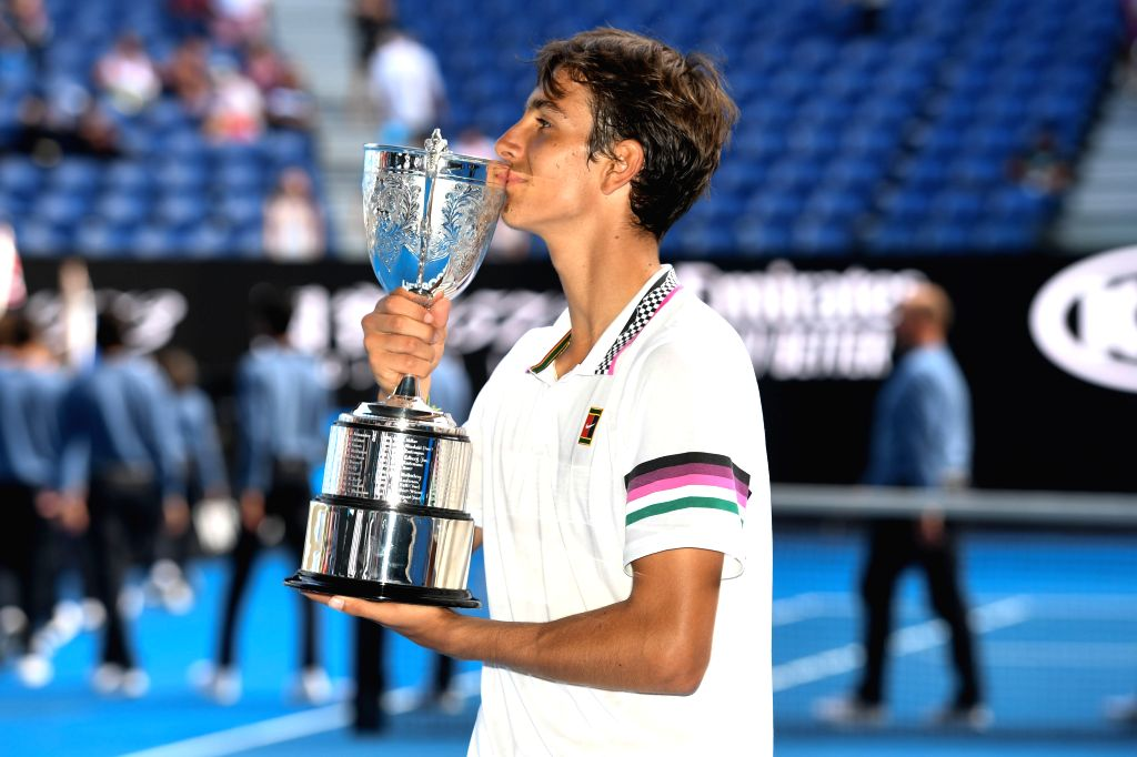 MELBOURNE, Jan. 26, 2019 - Lorenzo Musetti of Italy poses for photographs after winning his boys' singles Final match against Emilio Nava of the United States at 2019 Australian Open at Melbourne ...
