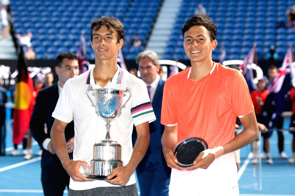 MELBOURNE, Jan. 26, 2019 - Lorenzo Musetti of Italy and Emilio Nava of the United States pose for photographs after their boys' singles Final match at 2019 Australian Open at Melbourne Park in ...