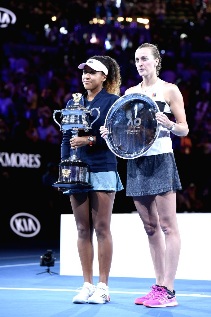 MELBOURNE, Jan. 26, 2019 - Naomi Osaka (L) of Japan and Petra Kvitova of the Czech Republic pose during the trophy awarding ceremony after the women's singles final match between Naomi Osaka of Japan ...