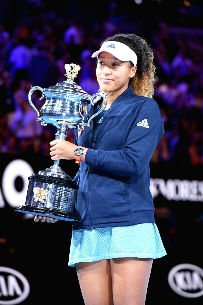 MELBOURNE, Jan. 26, 2019 - Naomi Osaka of Japan holds up the trophy during the trophy awarding ceremony after the women's singles final match between Naomi Osaka of Japan and Petra Kvitova of the ...