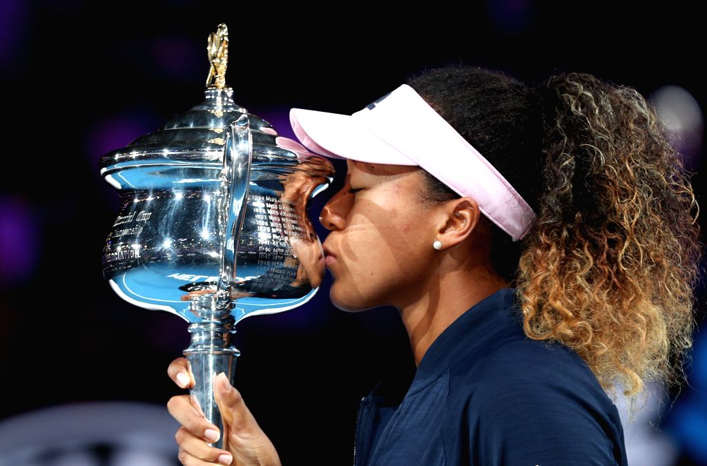 MELBOURNE, Jan. 26, 2019 - Naomi Osaka of Japan kisses the trophy during the trophy awarding ceremony after the women's singles final match between Naomi Osaka of Japan and Petra Kvitova of the Czech ...