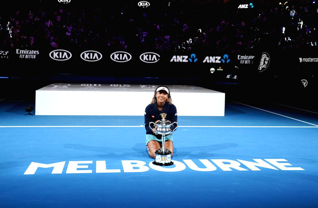 MELBOURNE, Jan. 26, 2019 - Naomi Osaka of Japan reacts during the trophy awarding ceremony after the women's singles final match between Naomi Osaka of Japan and Petra Kvitova of the Czech Republic ...
