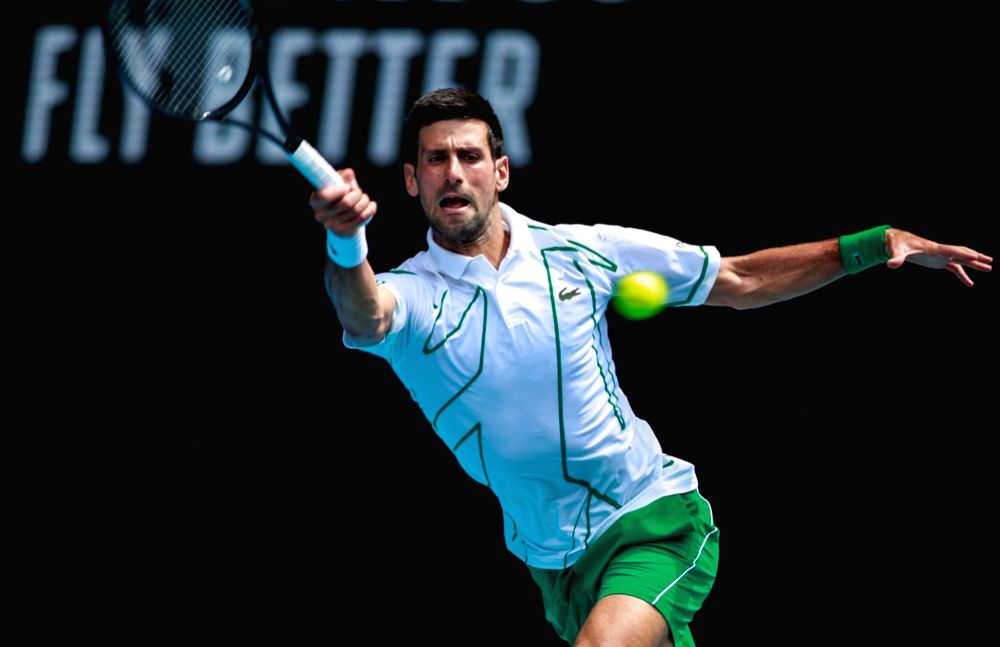 MELBOURNE, Jan. 26, 2020 (Xinhua) -- Novak Djokovic of Serbia hits a return during the men's singles 4th round match against Diego Schwartzman of Argentina at the Australian Open tennis championship in Melbourne, Australia on Jan. 26, 2020. (Xinhua/W