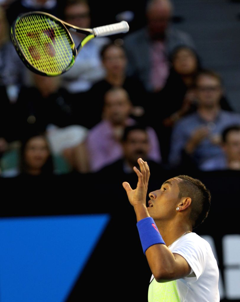 Nick Kyrgios of Australia throws his racket into the air during the men's singles quarterfinals match against Andy Murray of Great Britain on day nine of 2015 ...