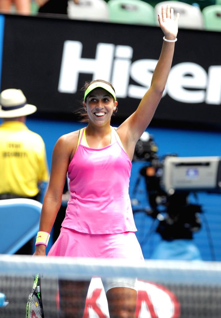 Madison Keys of the United States celebrates the victory after the women's quarterfinal match against her compatriot Venus Williams at the Australian Open tennis .