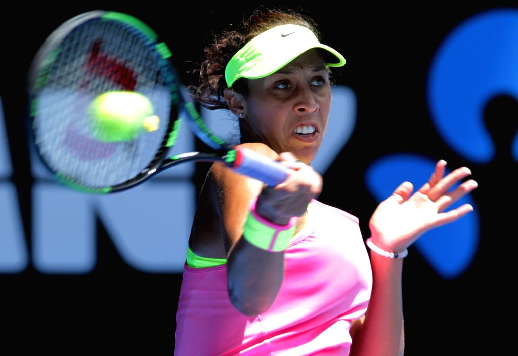 Madison Keys of the United States returns the ball during the women's quarterfinal match against her compatriot Venus Williams at the Australian Open tennis ...