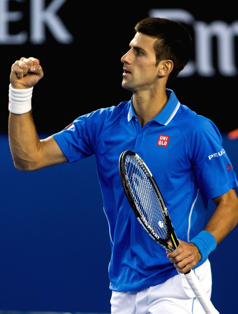 Novak Djokovic of Serbia reacts during the men's singles quarterfinal match against Milos Raonic of Canada on the day ten at the 2015 Australian Open Tournment at