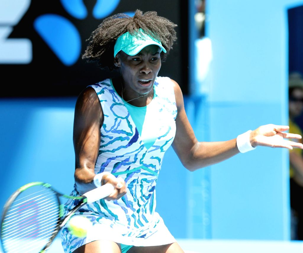 Venus Williams of the United States returns the ball during the women's quarterfinal match against her compatriot Madison Keys at the Australian Open tennis ...