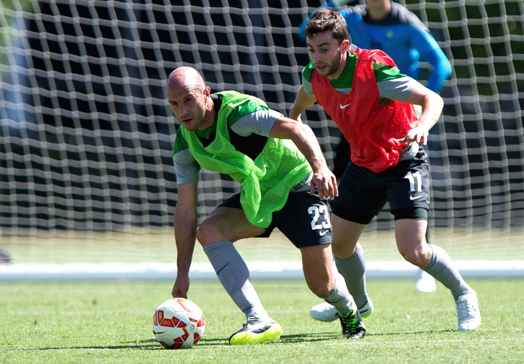 Socceroos player Mark Bresciano (Front) vies for the ball with Tommy Oar during the team training session ahead of AFC Asian Cup at the Collingwood Training ...