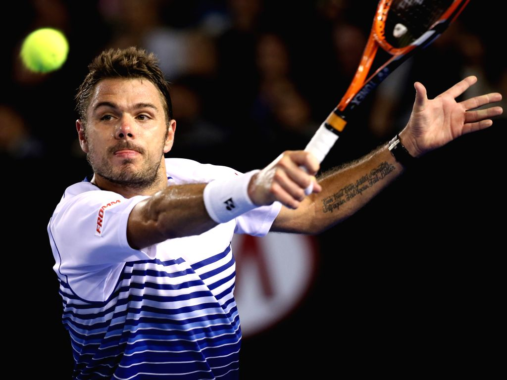 Switzerland's Stanislas Wawrinka returns the ball during his men's singles semifinal match against Serbia's Novak Djokovic at the Australian Open tennis ...