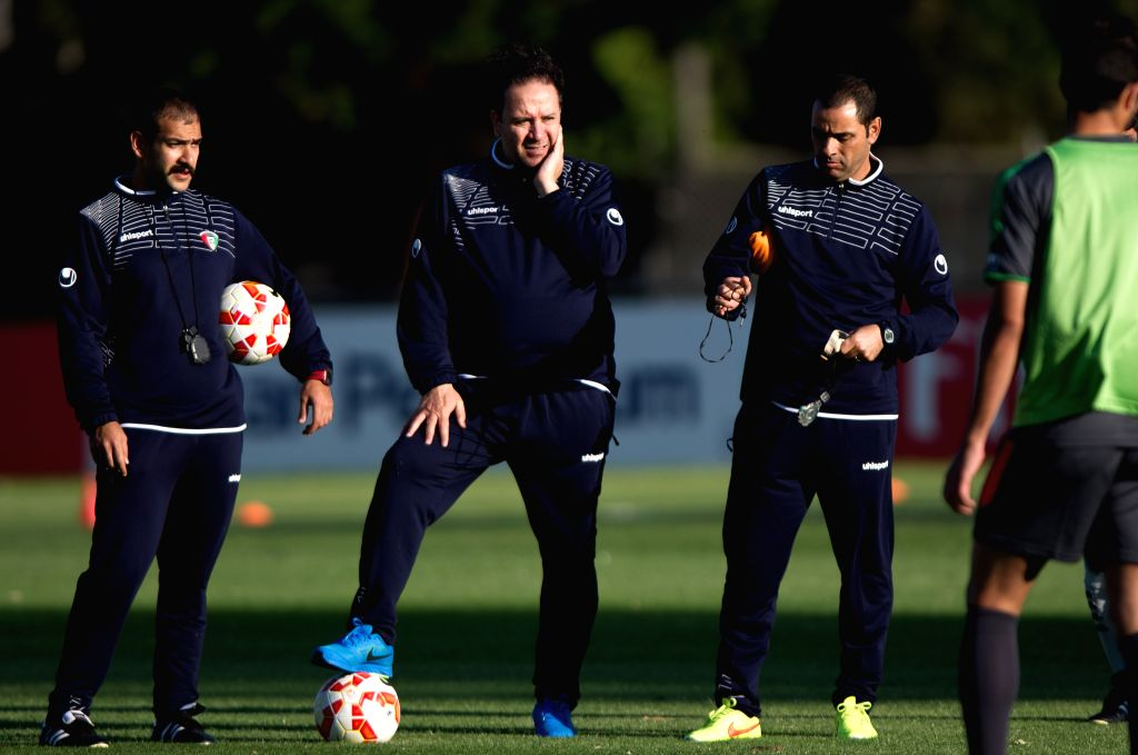 Nabil Maaloul (2nd L), the head coach of Kuwait  attends a training session ahead of the AFC Asian Cup at SS Anderson Stadium in Melbourne, Australia, Jan. 5, ...