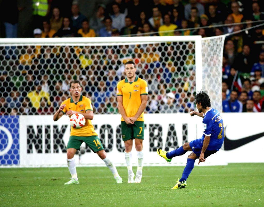 Ali Almaqseed (R) of Kuwait kicks the ball during the opening football match against Australia at the AFC Asian Cup in Melbourne, Australia, Jan. 9, 2015. ...