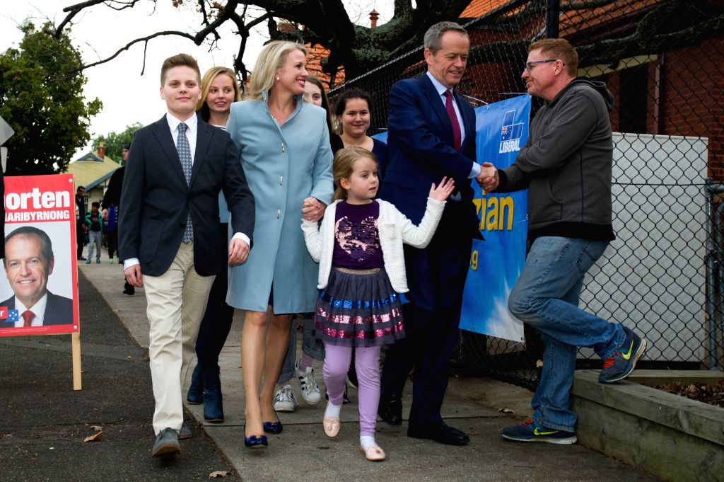 MELBOURNE, July 2, 2016 - Leader of the Australian Labor Party Bill Shorten (2nd R, front) and his wife Chloe Shorten (2nd L, front) visit the Moonee Ponds West Public School polling station to cast ...