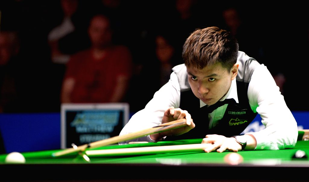Xiao Guodong of China competes during his quarterfinals match against Matthew Stevens of Great Britain at the 2014 Australian Goldfields Snooker Open in Bendigo, ..