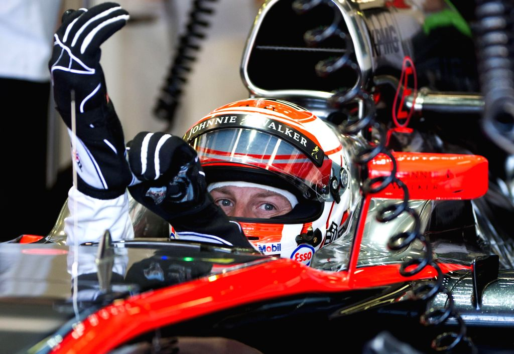 McLaren-Honda Formula One driver Jenson Button of Great Britain fine tunes during the second practice session ahead of Australian Formula One Grand Prix at ...
