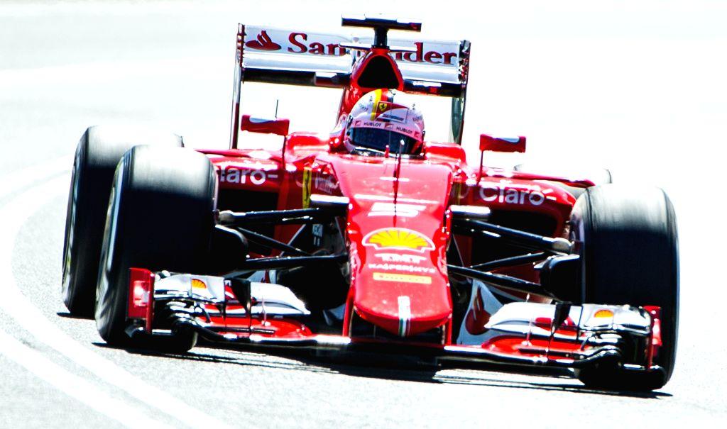 Scuderia Ferrari Formula One driver Sebastian Vettel of Germany races during the first practice session ahead of Australian Formula One Grand Prix at Albert Park ...