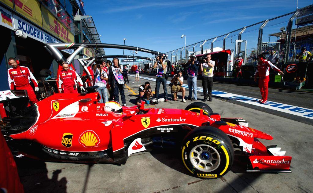 Scuderia Ferrari Formula One driver Sebastian Vettel of Germany drives during the second practice session ahead of Australian Formula One Grand Prix at Albert ...