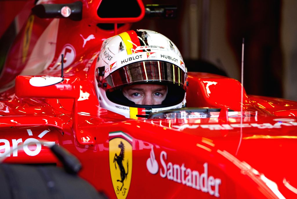 Scuderia Ferrari Formula One driver Sebastian Vettel of Germany fine tunes during the second practice session ahead of Australian Formula One Grand Prix at ...