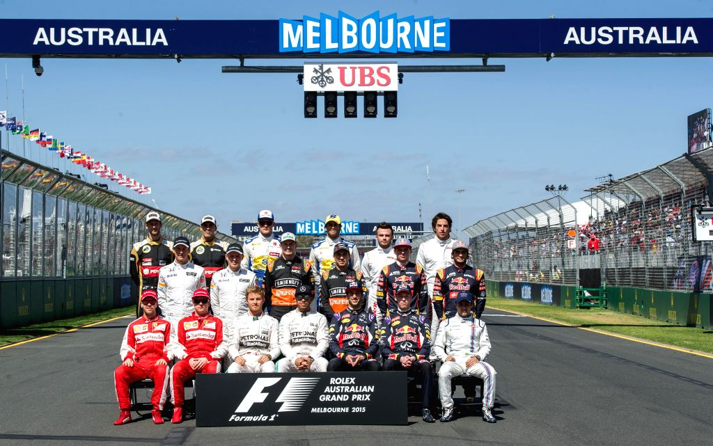 Formula One drivers pose for a group photo ahead of the Australian Formula One Grand Prix at the Albert Park circuit in Melbourne, Australia, March 15, 2015. ...