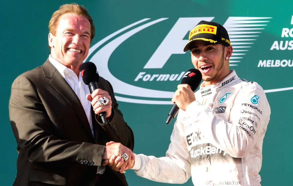 Mercedes AMG Petronas Formula One driver Lewis Hamilton (R) of Britain shakes hand with U.S. actor and former California governor Arnold Schwarzenegger after ...