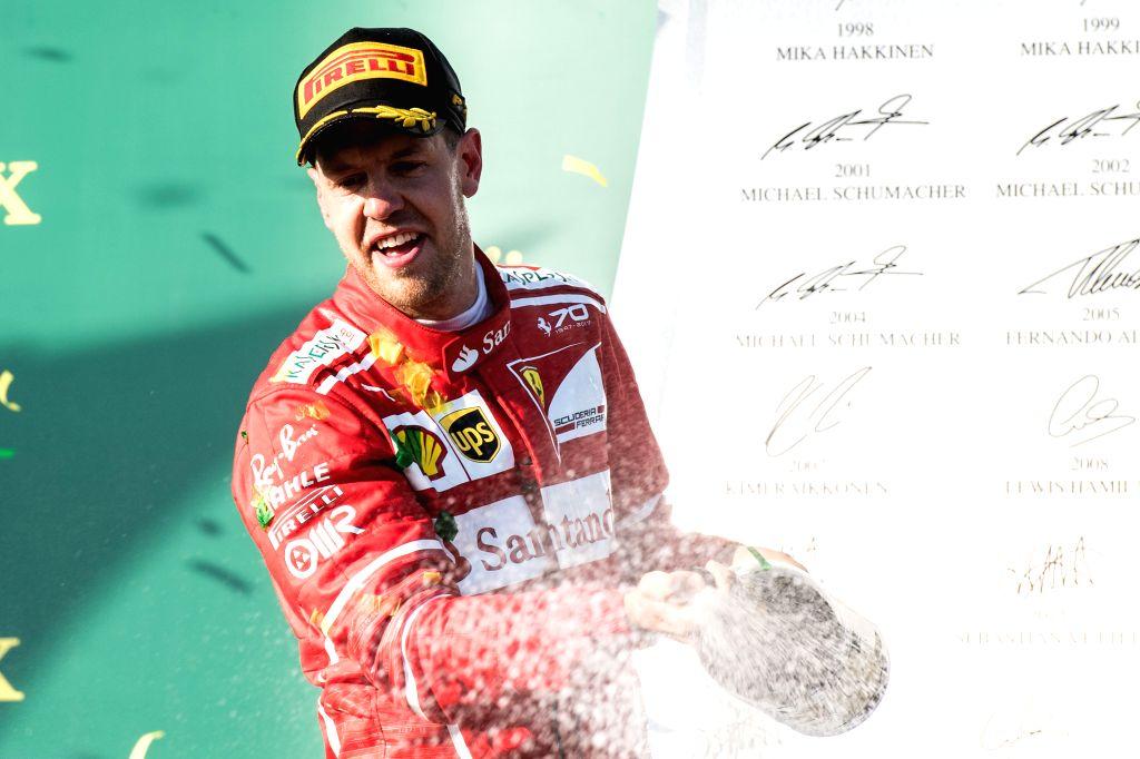 MELBOURNE, March 26, 2017 (Xinhua)  -- Scuderia Ferrari's German driver Sebastian Vettel celebrates during the awarding ceremony for the Australian Formula One Grand Prix at Albert Park circuit in Melbourne, Australia on March 26, 2017. (Xinhua/Bai X