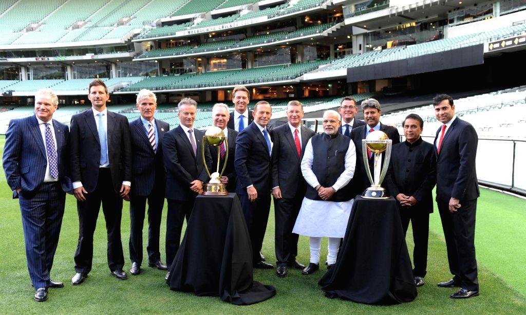Prime Minister Narendra Modi and Prime Minister of Australia, Tony Abbott with cricketers Sunil Gavaskar, Kapil Dev, V.V.S. Laxman, Steve Waugh, Allan Border, Glenn McGrath, Michael ... - Narendra Modi and Kapil Dev
