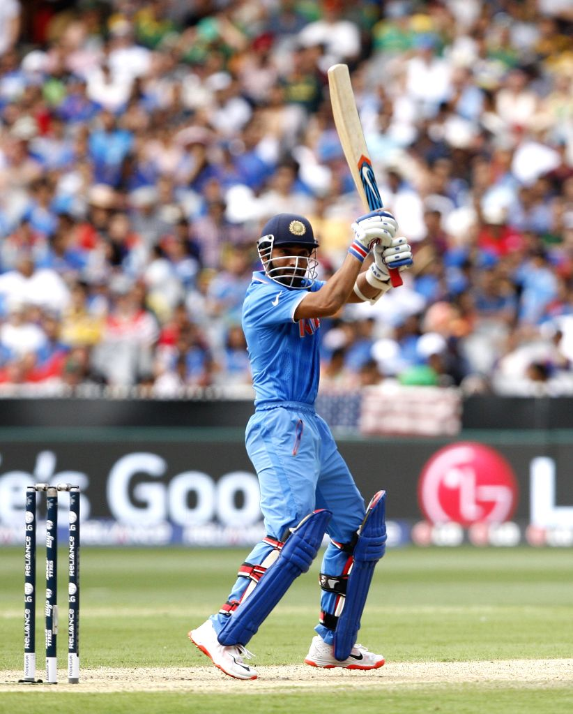 South African cricketer Ajinkya Rahane in action during an ICC World Cup 2015 match between India and South Africa at Melbourne Cricket Ground, Australia on Feb 22, 2015.