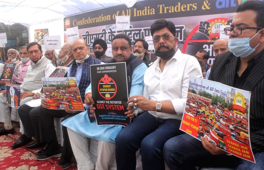 Membars of CAIT sitting demonstration at Chawri bazar for support Bharat band in new Delhi.