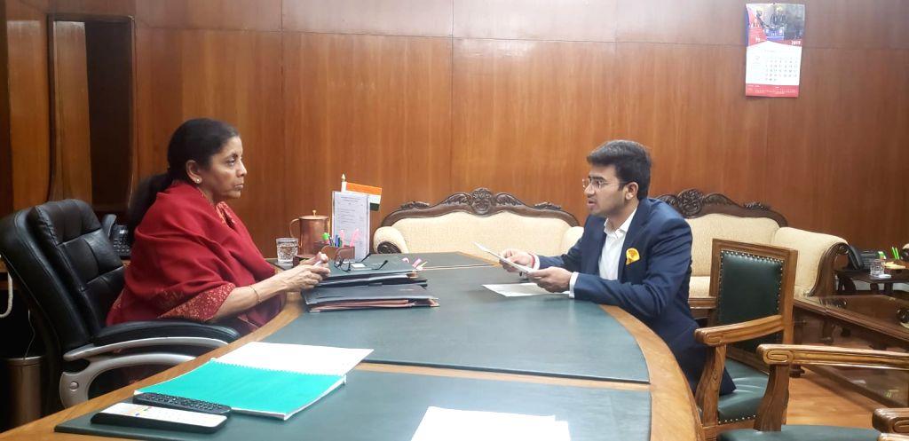 Member of Lok Sabha from Bangalore South, Tejasvi Surya calls on Union Finance and Corporate Affairs Minister Nirmala Sitharaman in New Delhi on Dec 12, 2019. - Nirmala Sitharaman