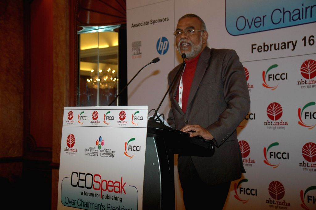 Member of Planning Commission Narendra Jadhav addresses during `CEOSpeak Over Chairman's Breakfast-2014`  programme organised by FICCI,  National Book Trust, India and Human Resource Development Ministry of Central Government in New Delhi