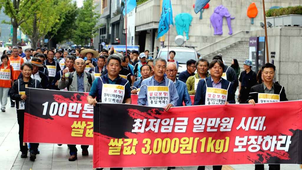 Members from Junnong, the general federation of farmers' associations, march toward the presidential office Cheong Wa Dae in Seoul on Oct. 10, 2017, while calling for the government to raise ...