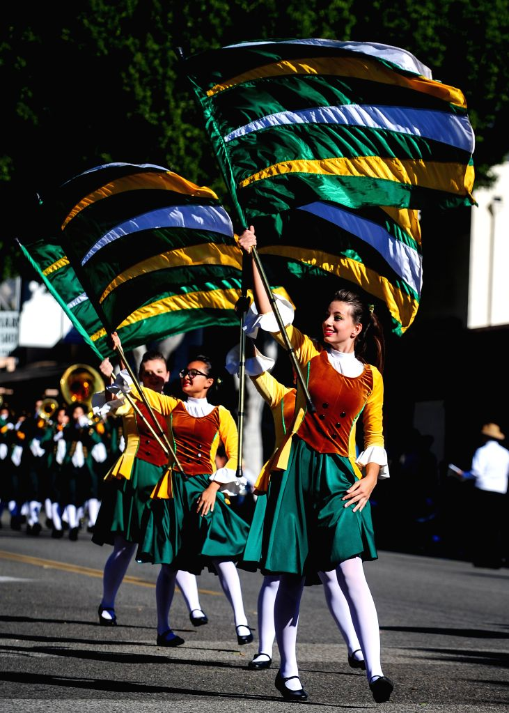 Members of a brass band from a high school of southern California attend the 62nd Festival of Bands Parade in the Baldwin Avenue in Arcadia, Los Angeles, the ...
