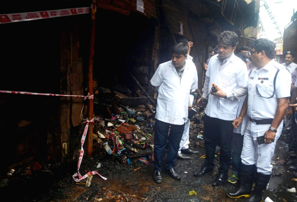 Members of a forensic team carry out inspection at the Bagri market where a fire broke out on Sunday; in Kolkata on Sept 20, 2018.