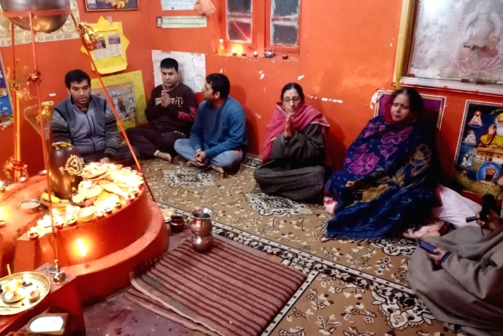 Members of a Kashmiri Pandit family during Diwali Puja at their residence in Jammu and Kashmir's Baramulla on Nov 14, 2020.