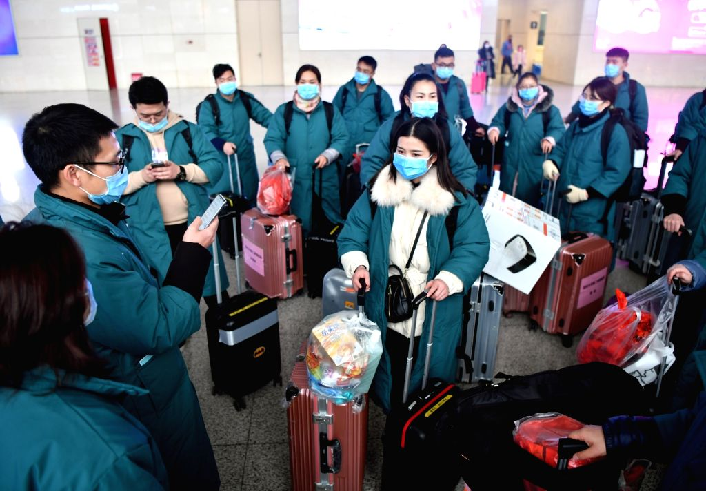 Members of a medical team gather at Zhengzhou East railway station in Zhengzhou, central China's Henan Province, on Jan. 26, 2020. A team comprised of 137 members ...