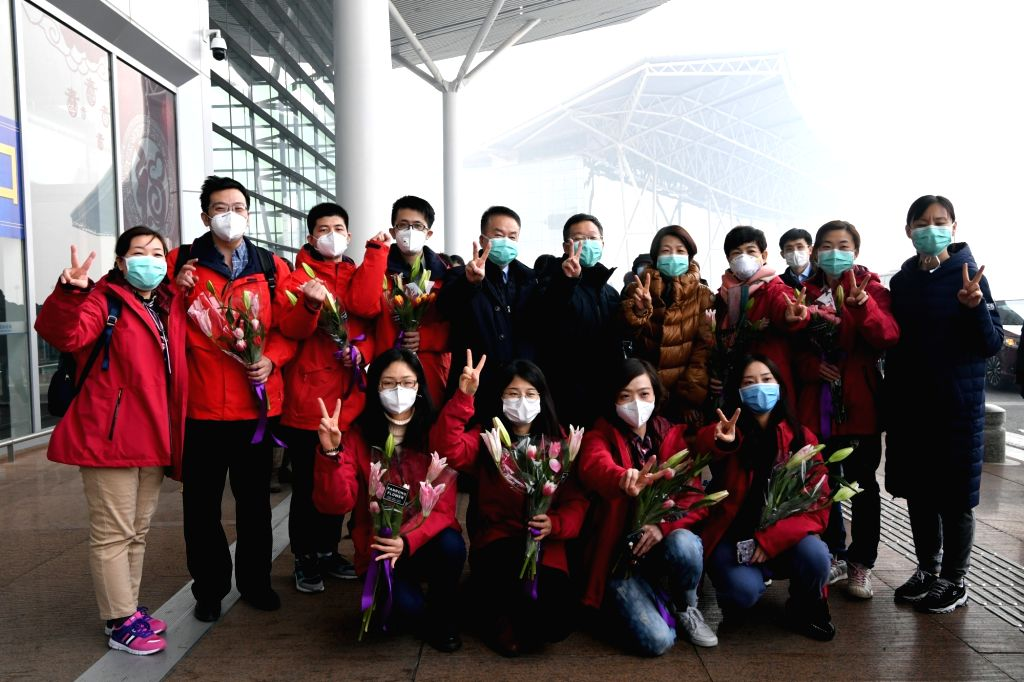 Members of a medical team pose for a group photo before their departure at Tianjin Binhai International Airport in Tianjin, north China, on Jan. 26, 2020. A team ...