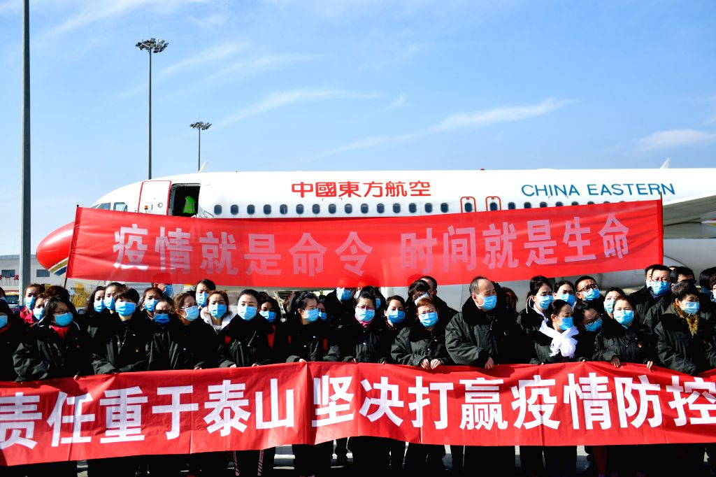 Members of a medical team pose for a group photo before their departure to Wuhan of Hubei Province, in Xining, northwest China's Qinghai Province, Jan. 28, 2020. A ...