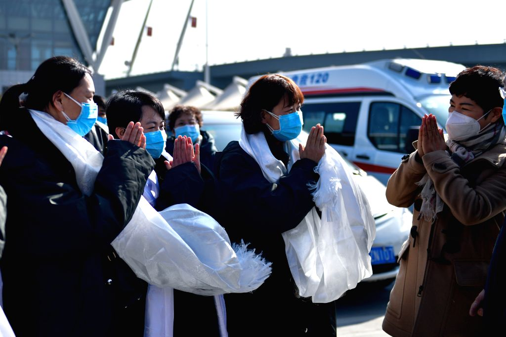 Members of a medical team send good wishes to each other before their departure to Wuhan of Hubei Province, in Xining, northwest China's Qinghai Province, Jan. 28, ...