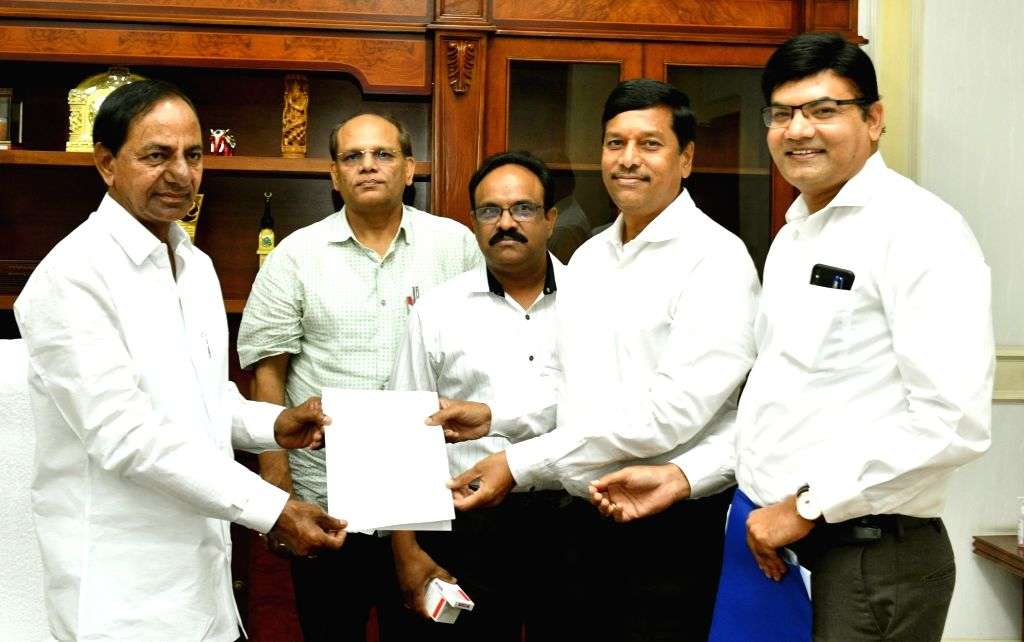 Members of a pharma company hand over a cheque to Chief Minister K. Chandrashekar Rao, as a donation to the Chief Minister's Fund during 21-day lockdown imposed to contain the spread of ... - K. Chandrashekar Rao