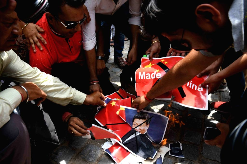 Members of a right wing group stage a demonstration to press for boycott of Chinese products in front of the Chinese Embassy in New Delhi on July 4, 2017.