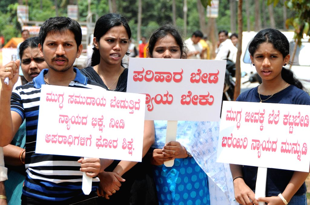 Members of Akhila Karnataka Kothari Welfare Association against government's failure to curb crime against women in Bangalore on July 20, 2014.