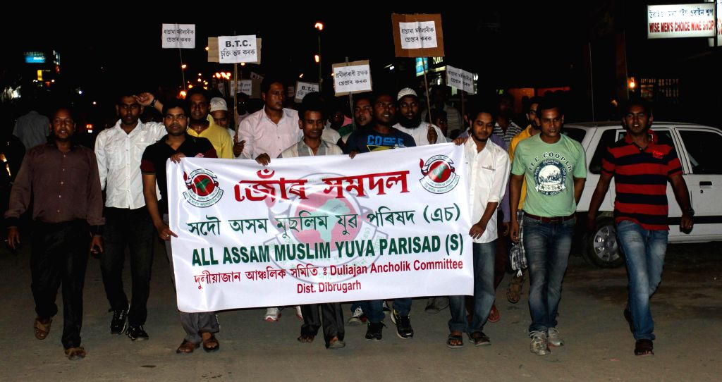 Members of All Assam Muslim Yuva Parishad protest against the recent violence in Bodoland Territorial Area Districts (BTAD) of Assam, at Duliajan in Dibrugarh district of Assam on May 6, 2014.