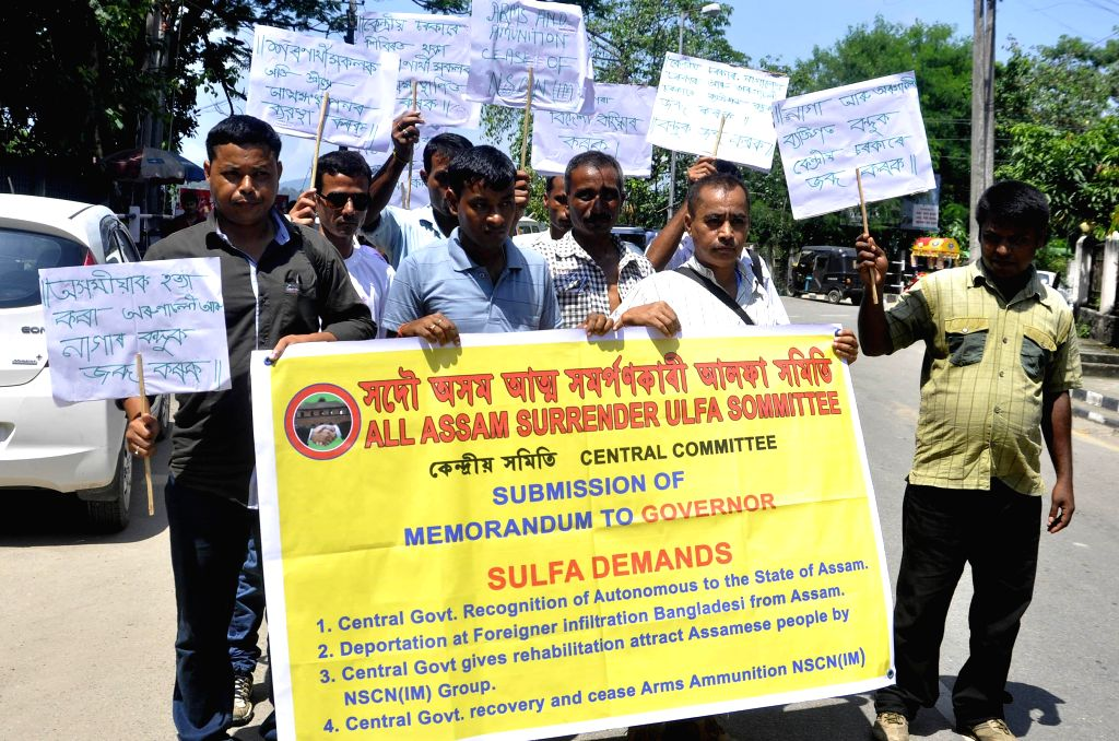 Members of All Assam Surrendered ULFA Samiti participate in a protest rally to demand seizure of arms from National Socialist Council of Nagaland Isak-Muivah in Guwahati on Sept 10, 2014.
