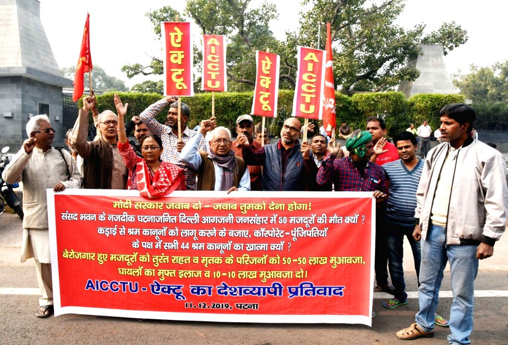 Members of All India Central Council of Trade Unions (AICCTU) stage a demonstration against the death of laborers hailing from Bihar who died in a recent Delhi factory fire; in Patna on Dec ...