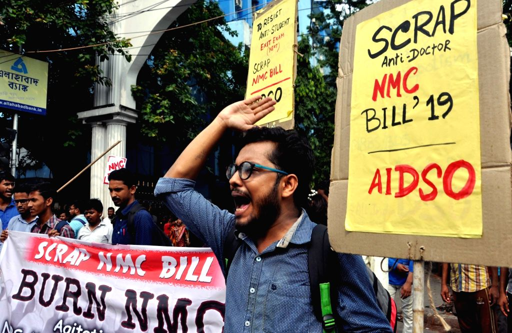 Members of All India Democratic Students' Organisation (AIDSO) protest against the National Medical Commission (NMC) Bill outside NRS Medical College and Hospital in Kolkata, on July 25, ...