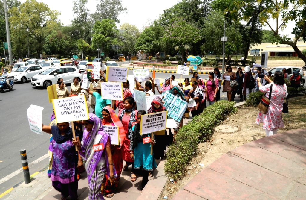 Members of All India Democratic Women's Association stage a demonstration questioning the clean chit given to Chief Justice Ranjan Gogoi in a sexual harassment case and to press for the ...