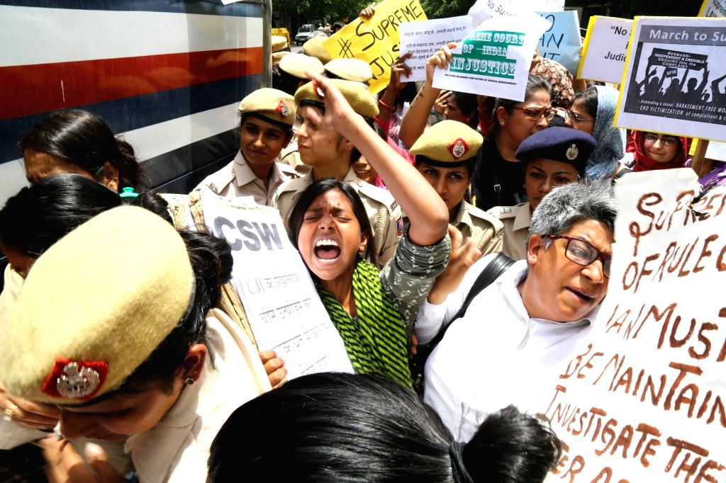 Members of All India Democratic Women's Association being taken away by police during  a demonstration questioning the clean chit given to Chief Justice Ranjan Gogoi in a sexual harassment ...