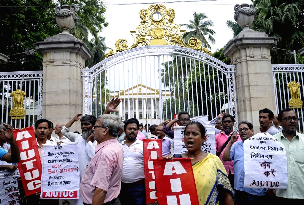 Members of All India United Trade Union Centre (AIUTUC) protest against the privatization of public sector undertakings (PSUs), outside Raj Bhavan in Kolkata on July 25, 2019.