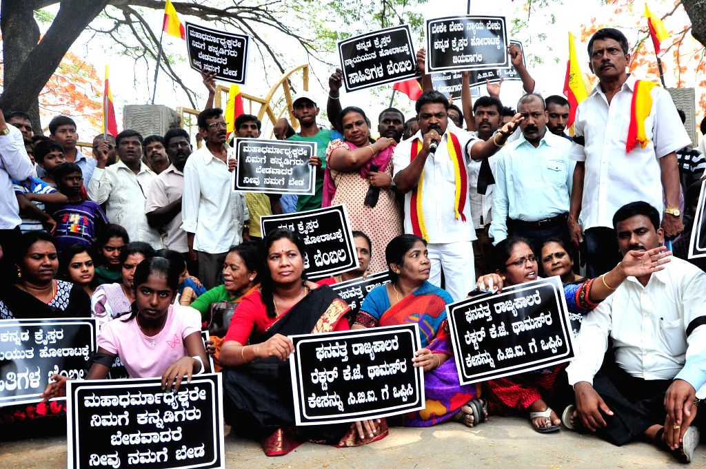 Members of All Karnataka Catholic Christian Kannada Association demonstrate at Kammanahalli to demand CBI inquiry in KJ Thomas murder case in Bangalore on April 27, 2014.