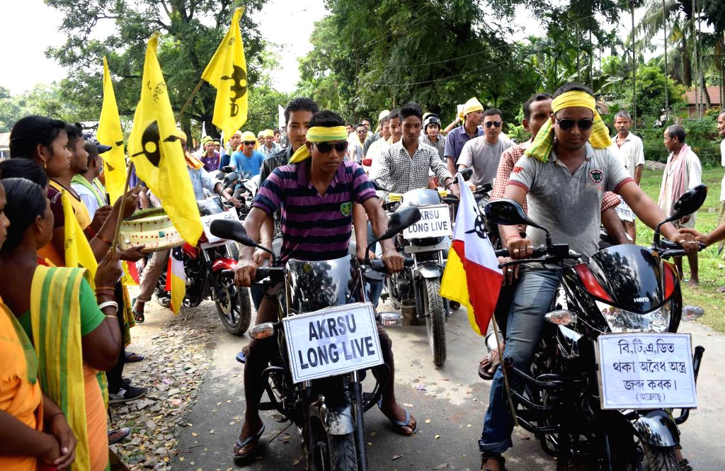Members of All Koch-Rajbongshi Students Union (AKRSU) take out a bike rally to demand seizure of illegal arms in BTAD of Kokrajhar on Sept 12, 2014.